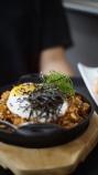 Kimchi Fried Rice, kimchi, beef, sunny side up egg, scallion, shaved nori with sesame seeds