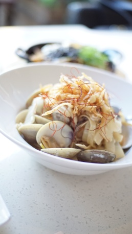 White Kimchi Clam Pasta white kimchi, clams, white wine sauce, thin dried red pepper and fried onions