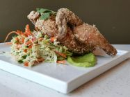 Half Fried Hen & Slaw fried Cornish Hen with a side of coleslaw and avocado crema (Joshua Lurie Food-GPS)