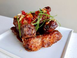 Baby Back Ribs fried pork ribs smothered in a sweet and spicy sauce, peanuts, Fresno, scallions (Joshua Lurie Food-GPS)